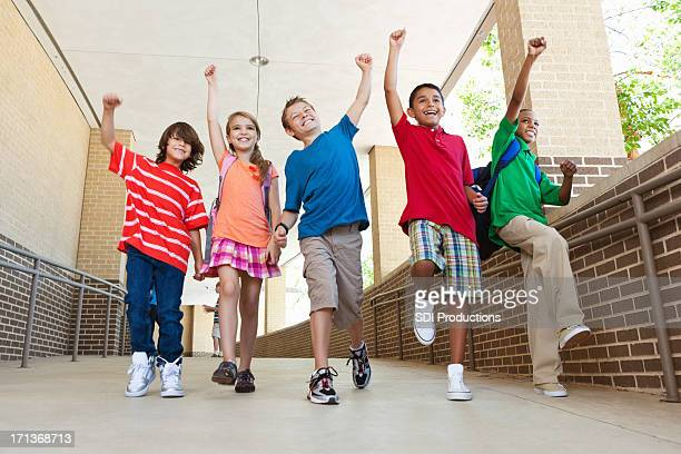 Happy group of elementary students expression after school