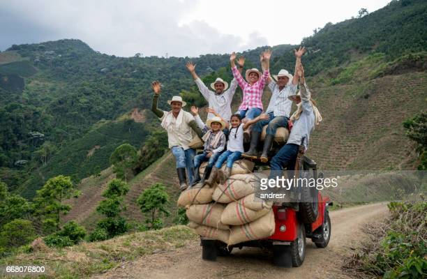 happy group of farmers transporting coffee on a car - south america stock pictures, royalty-free photos & images