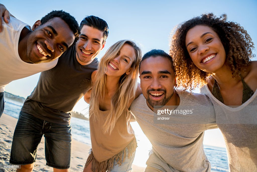 Happy group of friends at the beach : Stock Photo