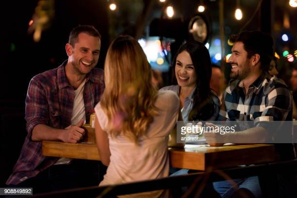 happy group of friends eating at a restaurant - pub stock pictures, royalty-free photos & images