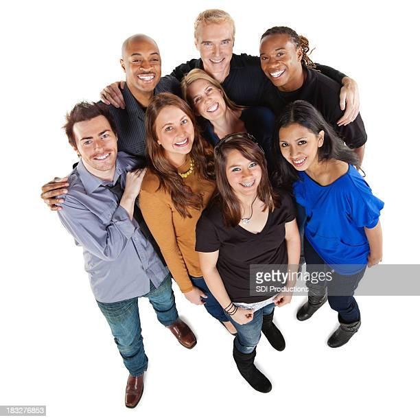 Heureux groupe d'amis, un corps, isolé sur blanc