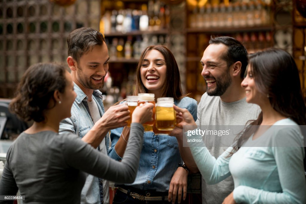 Happy group of friends making a toast at a restaurant : Stock Photo