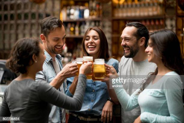 Happy group of friends making a toast at a restaurant