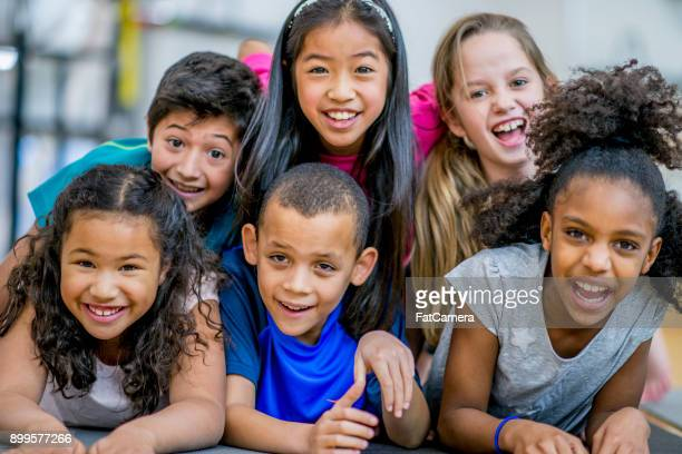 happy group of kids - 8 9 years photos stock photos and pictures