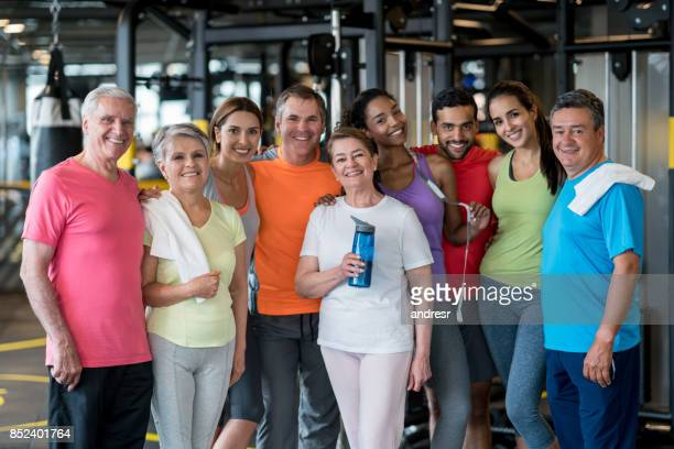 Happy group of people at the gym