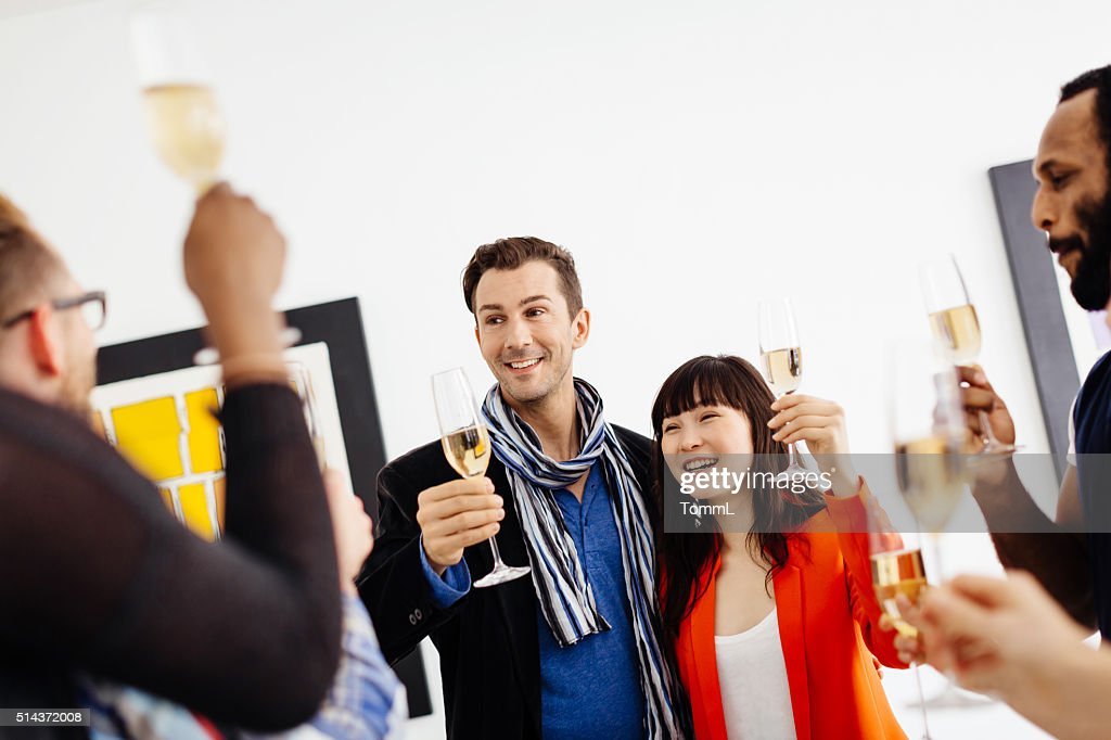 Happy group of people celebrating a gallery opening : Stock Photo