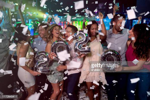 happy group of people celebrating the new year 2020 - happy new year 2020 stock photos and pictures