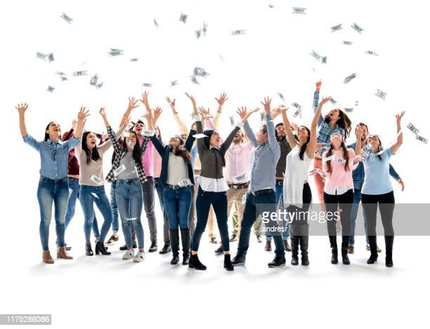 happy group of people grabbing money in the air - lottery stock pictures, royalty-free photos & images