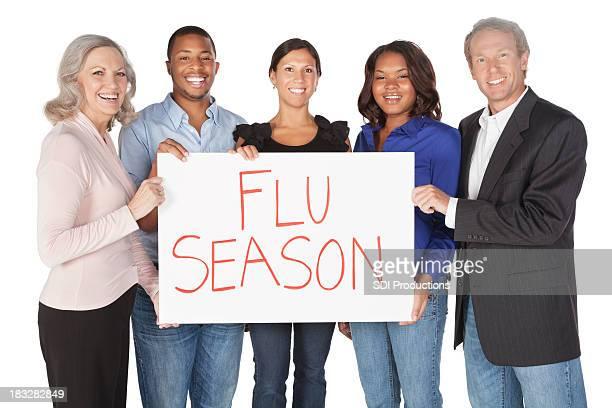 Happy Group of People Holding Flu Season Sign