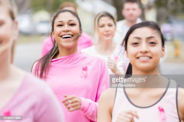 happy group of people participate in charity run - charity benefit stock pictures, royalty-free photos & images