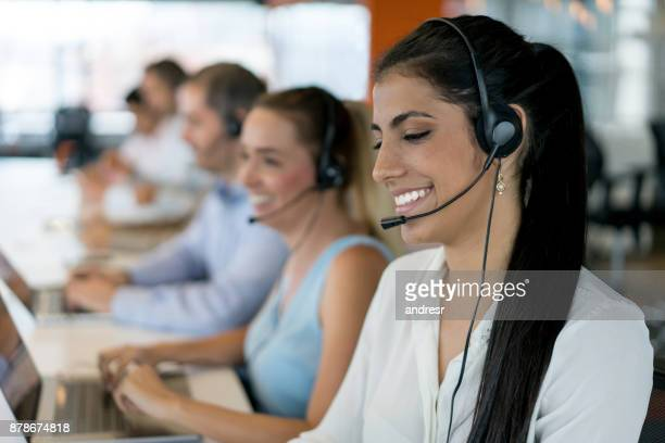 Happy group of people working at a call center