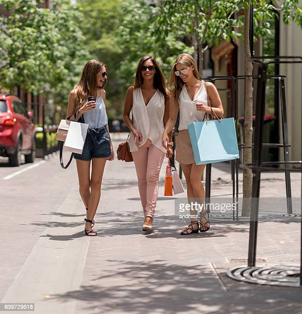 Happy group of shopping women in the city