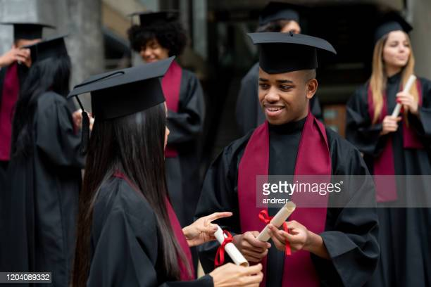 happy group of students talking on their graduation day - alumni stock pictures, royalty-free photos & images