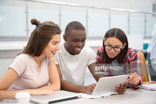 happy group of students working online in class - college application stock photos and pictures