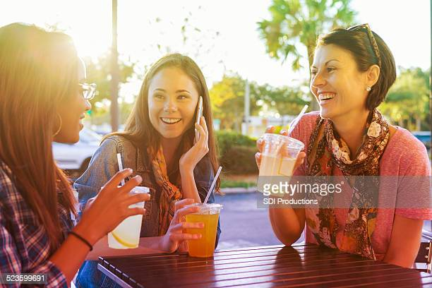 Happy group of woman having drink at outdoor coffee shop