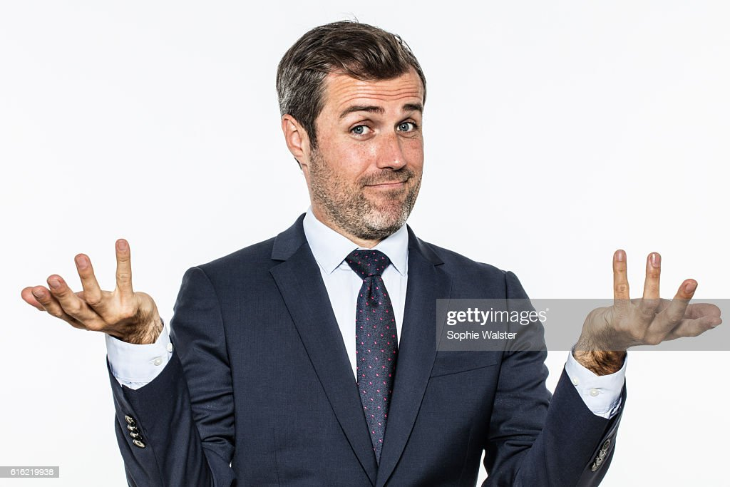 happy handsome business man showing hands up for carefree success : Stock Photo