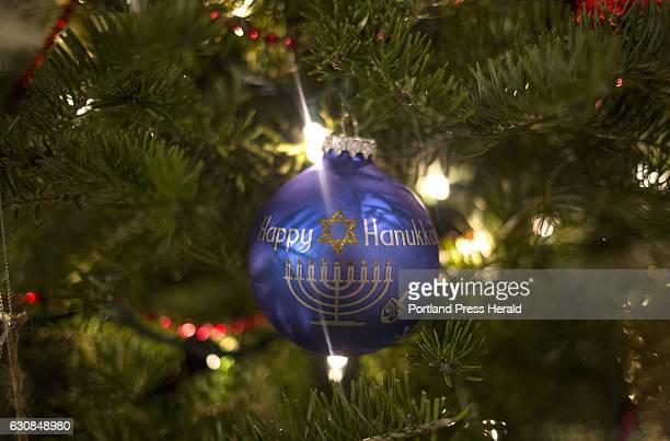 A 'Happy Hanukkah' ornament hangs on the Christmas tree at Amy Starr's home The family is helping Starr's boyfriend and the father of her youngest...