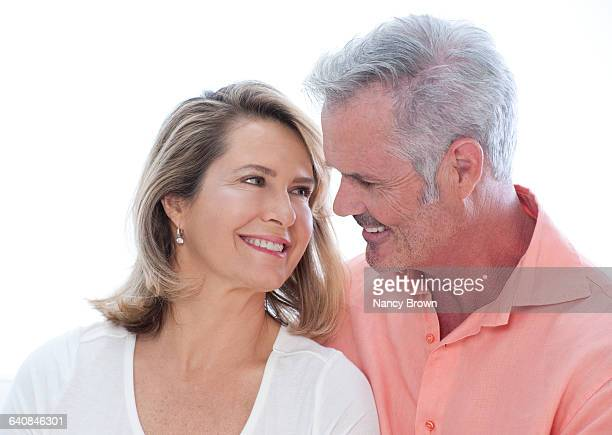 Happy Head Shot of Middle Age Couple Communicating