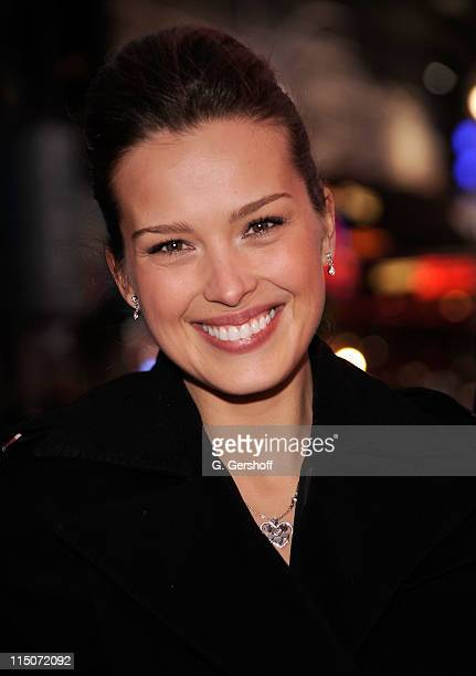 Happy Hearts founder and chair Petra Nemcova poses for pictures after ringing the NASDAQ closing bell on December 15 2009 in New York City