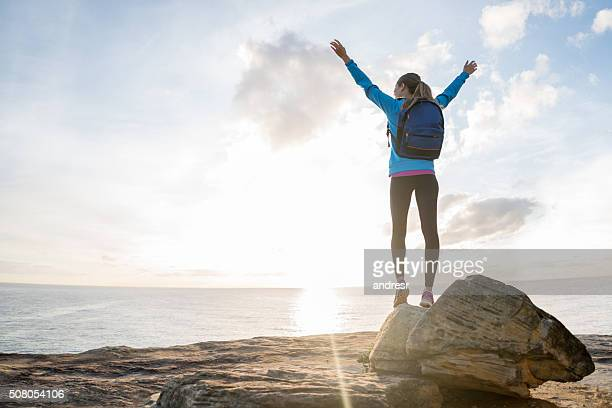 happy hiker reaching the top - on top of stock pictures, royalty-free photos & images