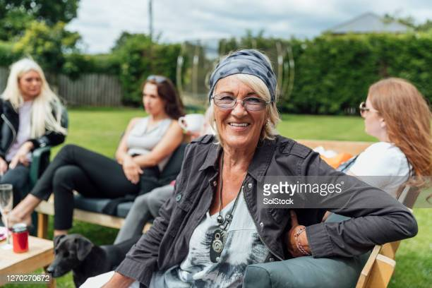 happy hipster grandmother - social distancing stock pictures, royalty-free photos & images