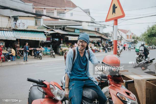 happy hipster men on a motorcycle at cool vacation stock photo - southeast asia stock pictures, royalty-free photos & images