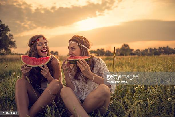 Happy hipsters in field