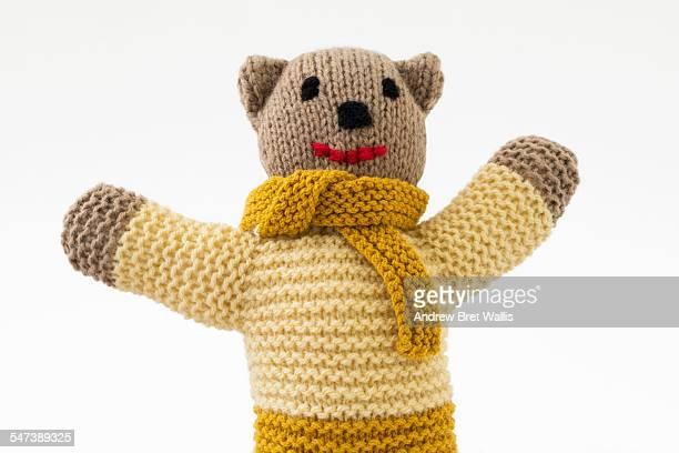Happy hnd knitted teddy bear