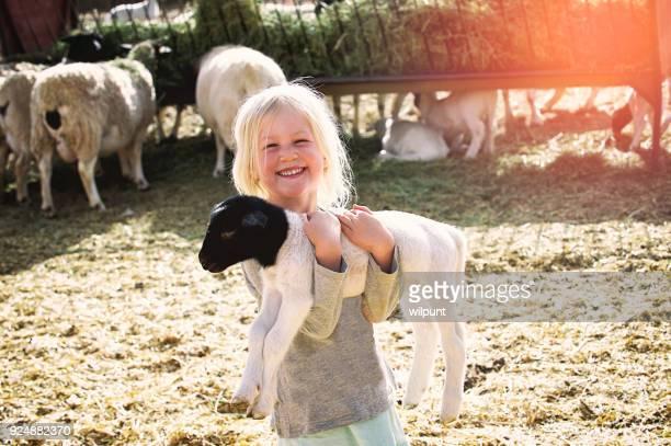 Happy holding lamb