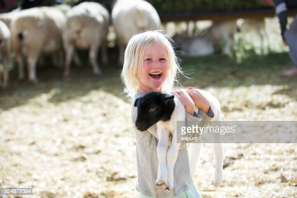 Happy holding lamb Smiling Girl