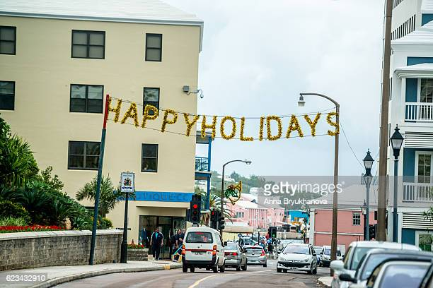 happy holidays banner of hamilton street, bermuda - happy holidays stock photos and pictures
