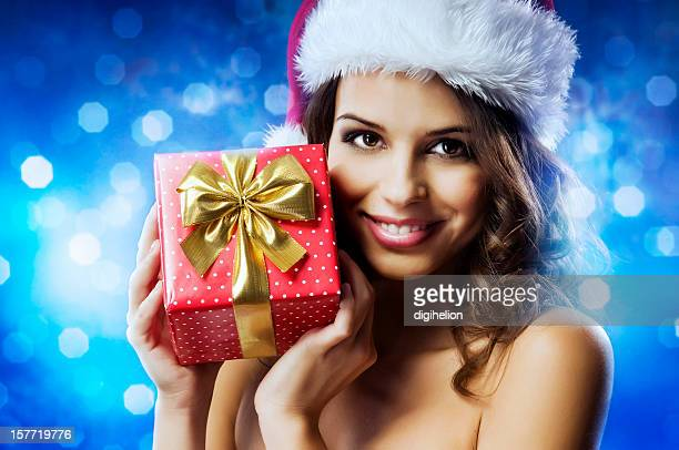 happy holidays - christmas girl with a present - happy holidays stock photos and pictures