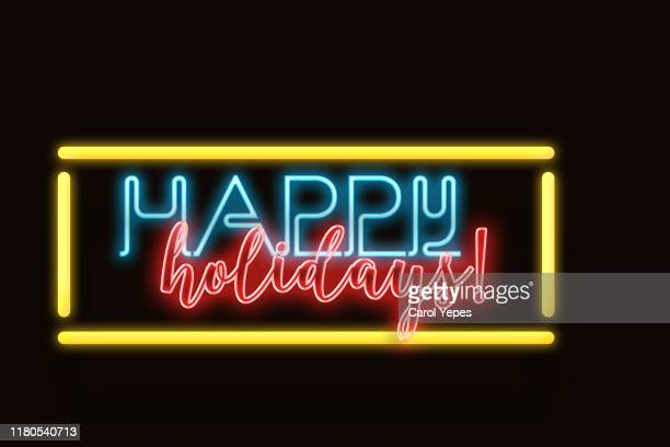 happy holidays in neon lights - happy holidays stock photos and pictures