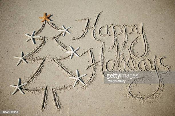Happy Holidays Message with Christmas Tree in Sand