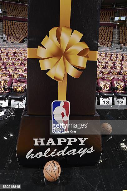 A happy holidays sign is seen before the game between the Golden State Warriors and the Cleveland Cavaliers on December 25 2016 at Quicken Loans...