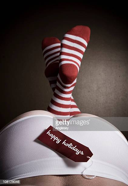 happy holidays tag on woman's underwear - happy holidays stock photos and pictures