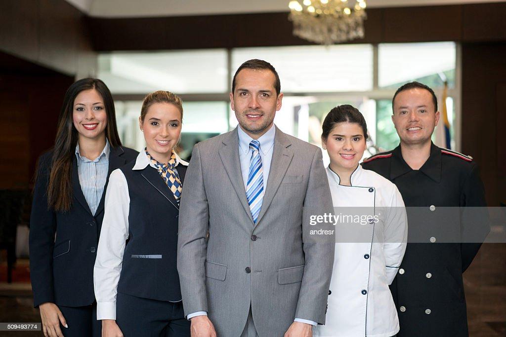 Happy hotel staff : Stock Photo