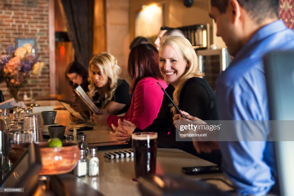 Happy hour for friends and coworkers in a bar. : Stock Photo
