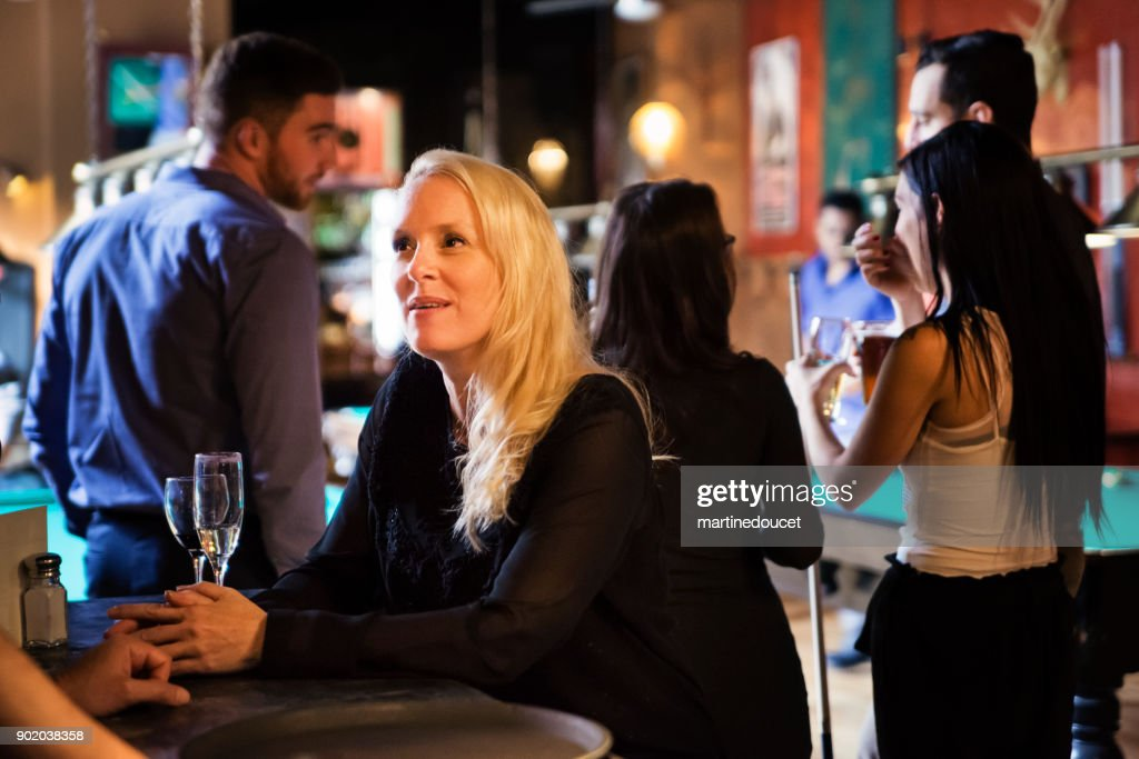 Happy hour for friends and coworkers in a bar playing pool. : Stock Photo