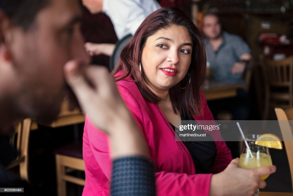 Happy hour for friends and coworkers in a resto-bar. : Stock Photo