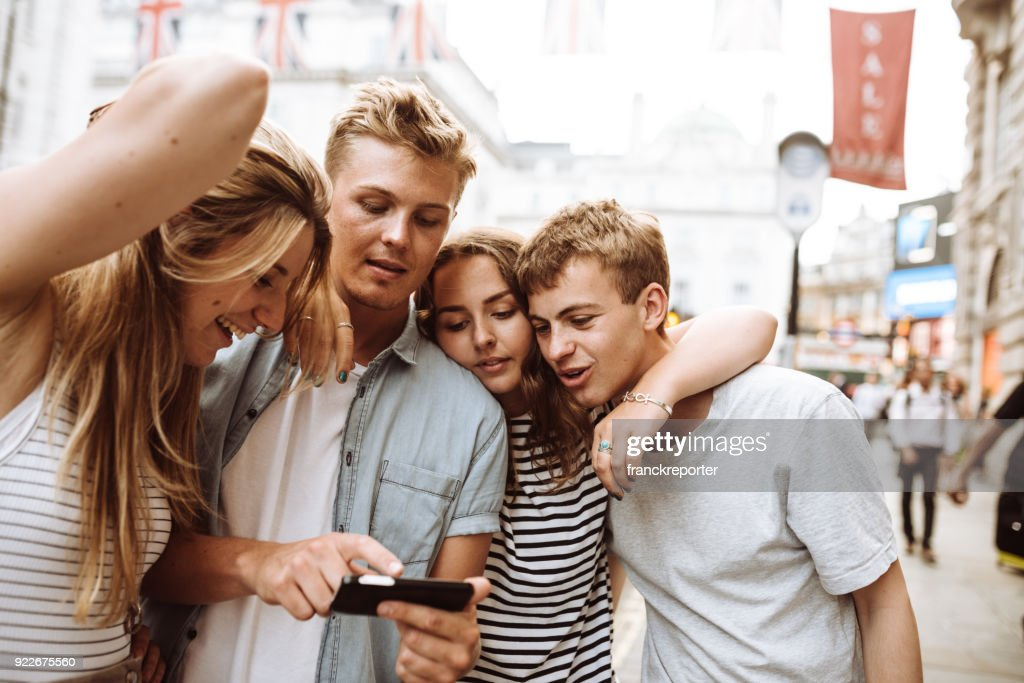 happy hour in london and checking the phone : Stock Photo