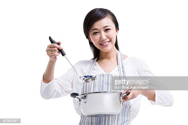 happy housewife preparing meal - ladle stock photos and pictures