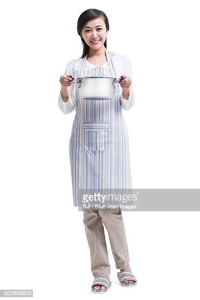 Happy housewife preparing meal