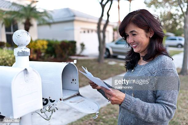 Happy Housewife receiving the mail