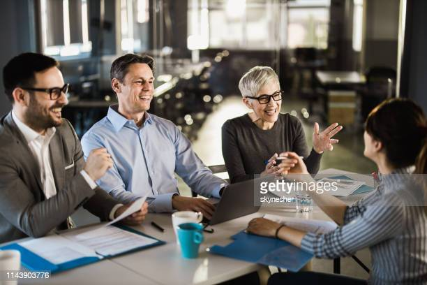 happy human resource team talking to female candidate on a job interview. - human resources stock pictures, royalty-free photos & images