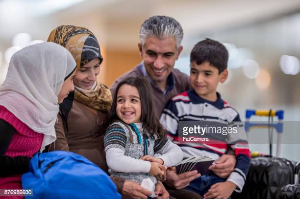 happy immigrant family - humanitarian aid stock pictures, royalty-free photos & images