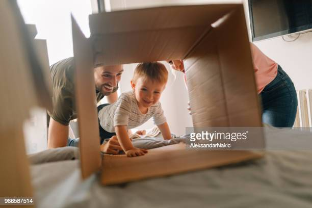 happy in our new family home - unpacking stock pictures, royalty-free photos & images