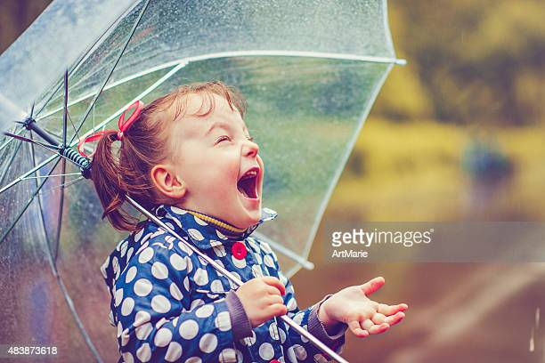 happy in rain - manufactured object stock pictures, royalty-free photos & images