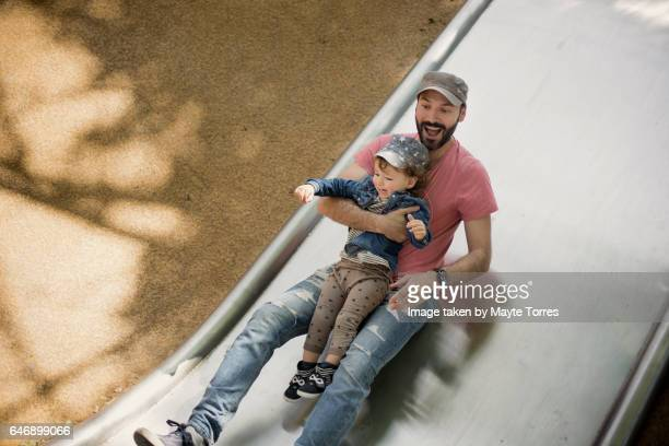Happy in the slide with dad