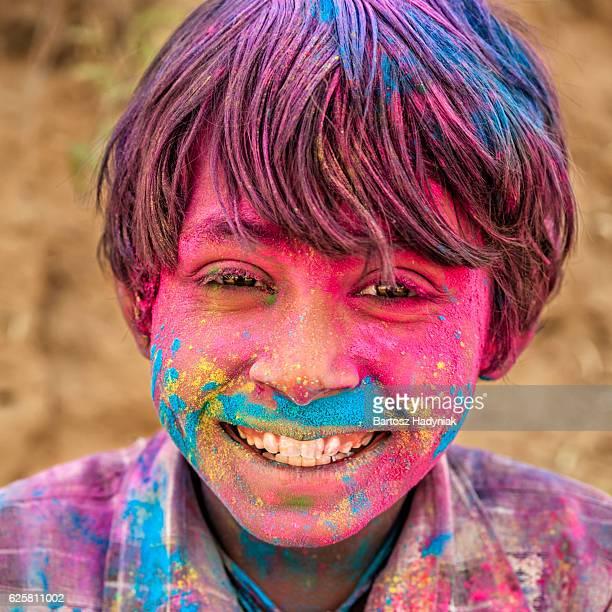 Happy Indian boy plays holi, desert village, India